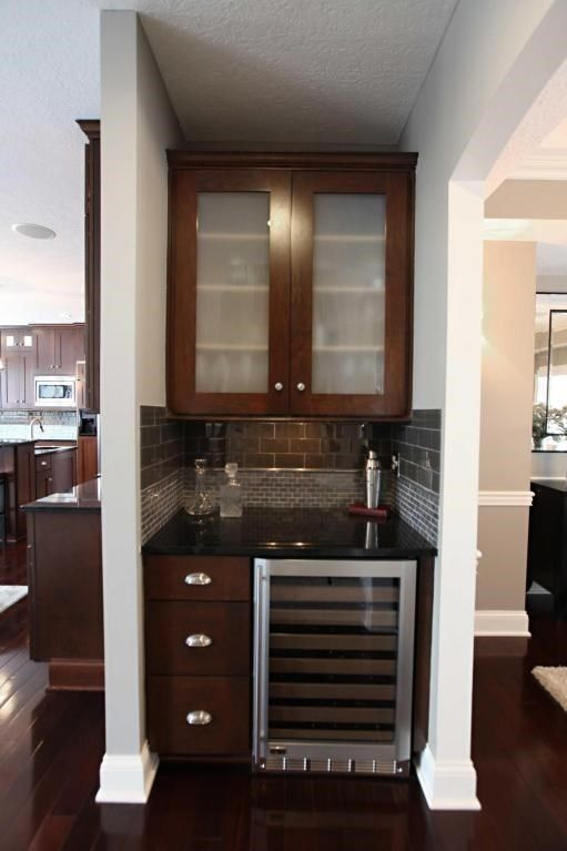 A Small Home Bar With A Single Wall Cabinet Tucked Into A Nook Between The  Kitchen And Dining Room For A Quick Pitstop.