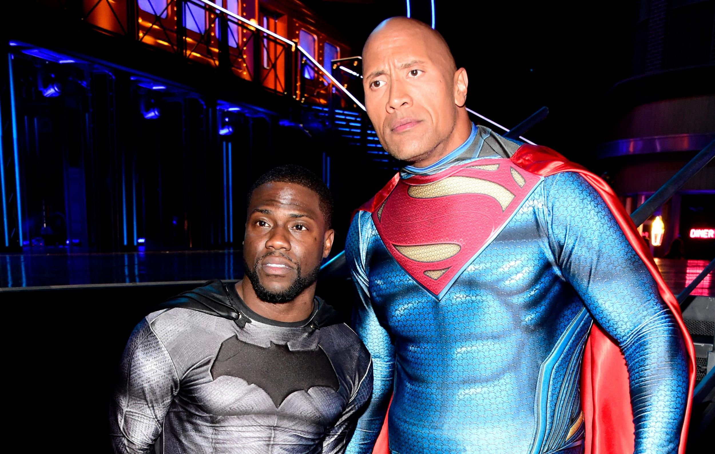 kevin hart with dwayne johnson wearing super hero costumesa great
