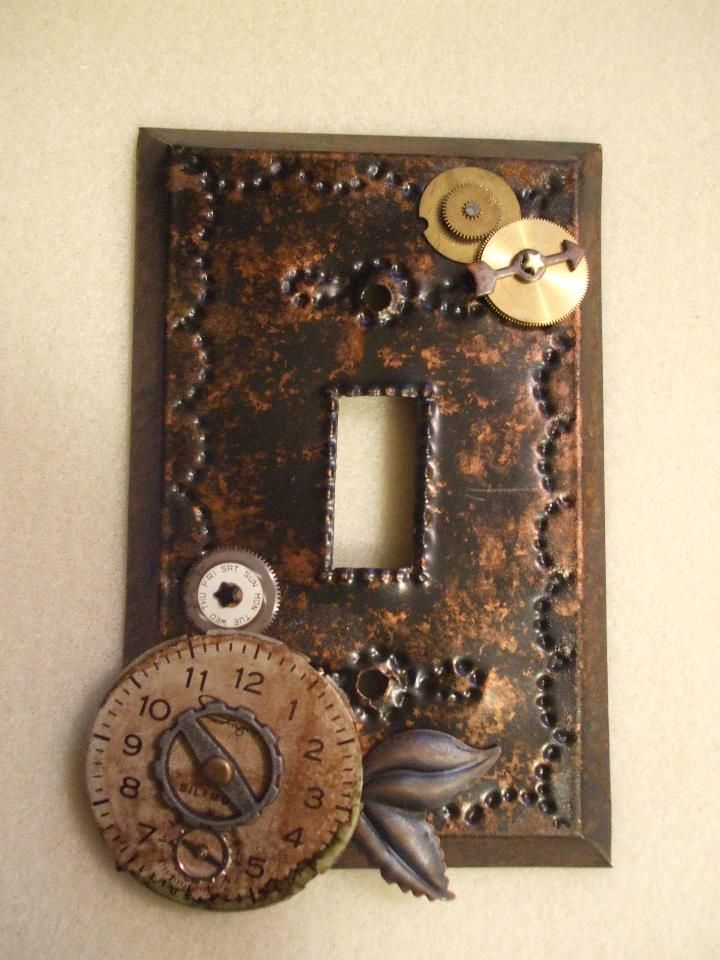 STEAMPUNK ACCESSORIES    Steampunk light switch covers. Tin cover antiqued and nail tapped design with antique watch gears and metal  embellishments. Most are drilled through the metal for a long lasting cover. Moveable parts. Made by Audra Phillips ©2011.