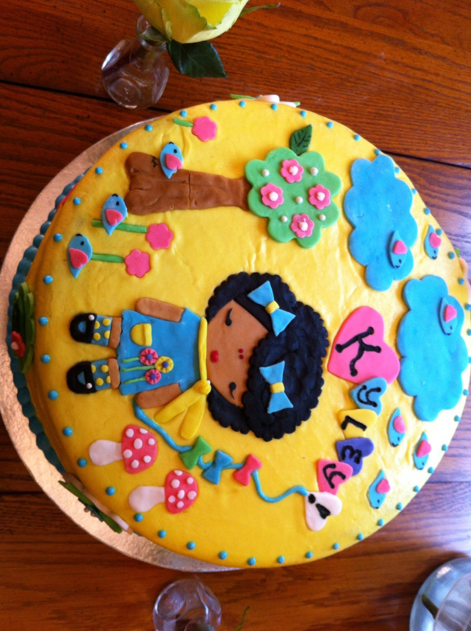 I made this Harajuku style cake for my daughter Kyley.  She has an afro and a heart kite. Sorry about the side shot. Leslie Jones Robinson.