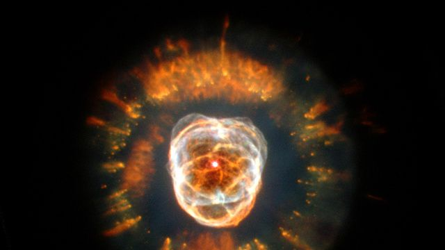 The Eskimo Nebula, NGC 2392 began forming 10,000 years ago and was first discovered by William Herschel in 1787. In the middle there is a dying star surrounded by some objects and gas.