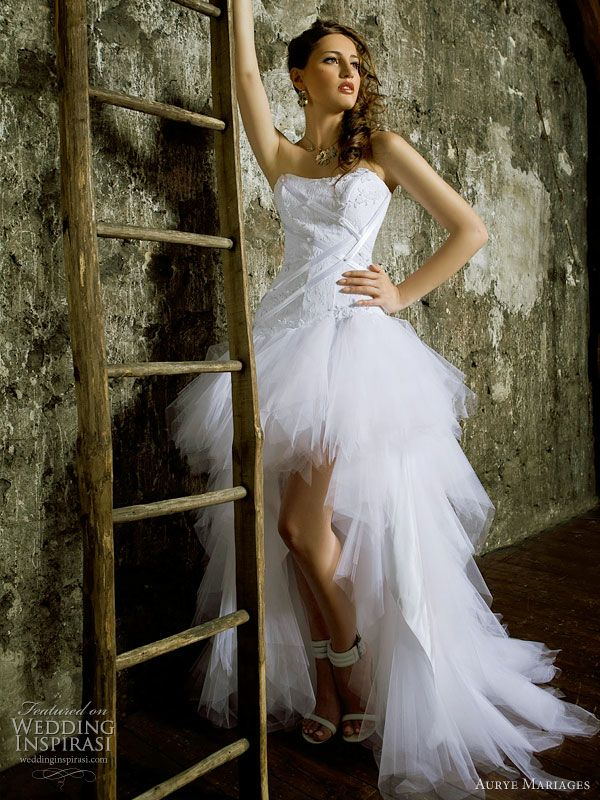 For some reason, I just LOVE wedding gowns that are short in front, long in back... actually, I love most dresses that are that way :P