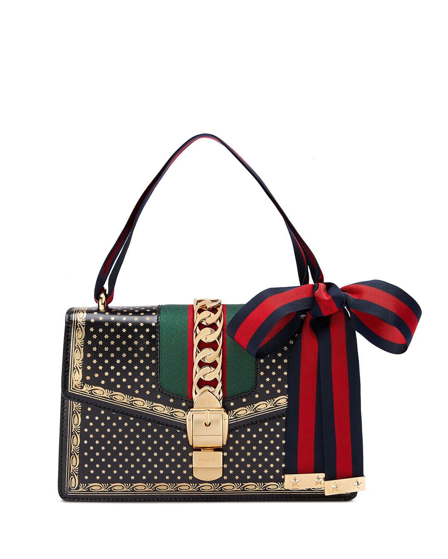d5248030e1b149 GUCCI SYLVIE SMALL STARS LEATHER SHOULDER BAG. #gucci #bags #shoulder bags # leather #lining #metallic #