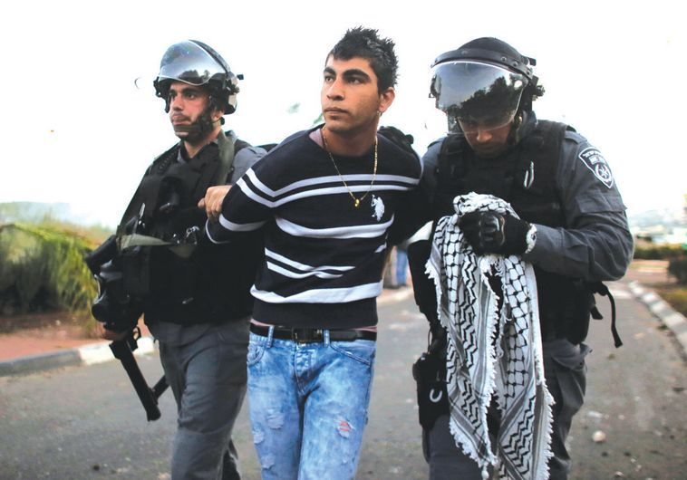 Police detain an Arab youth during clashes at the entrance to the town of Kfar Kanna, on November 8, Photo By: REUTERS