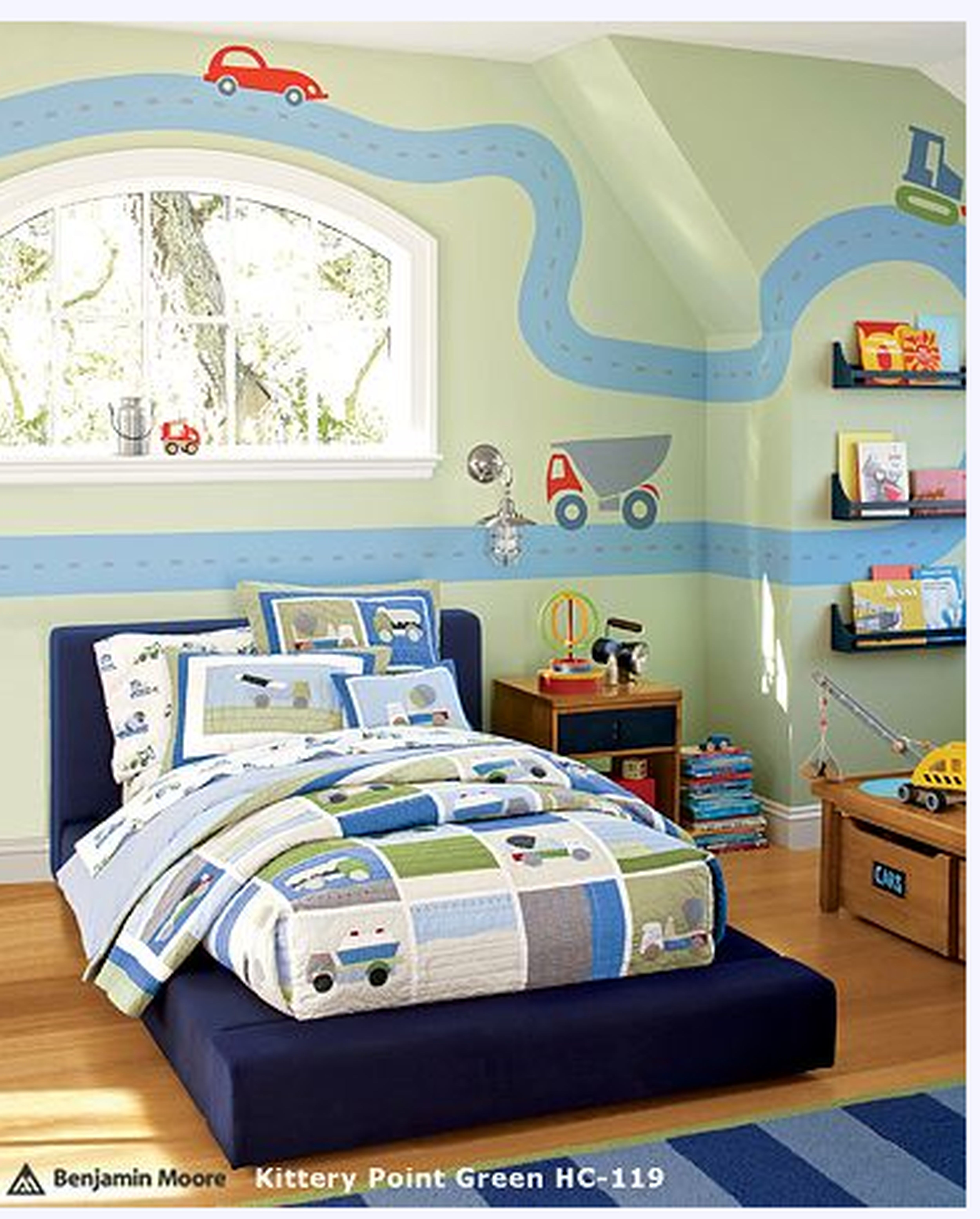 interior blue bed with white blue bed sheet with vehicles pictures