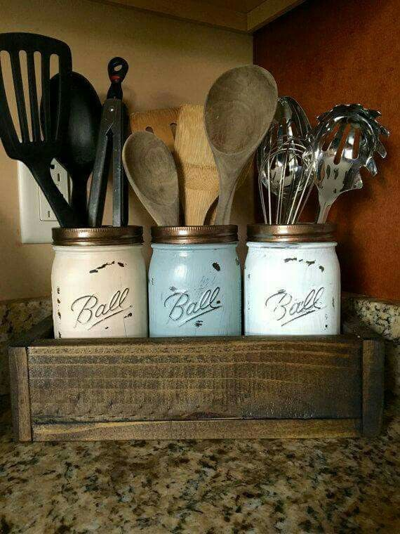 Mason jars done up a little bit Country in this utensil ...