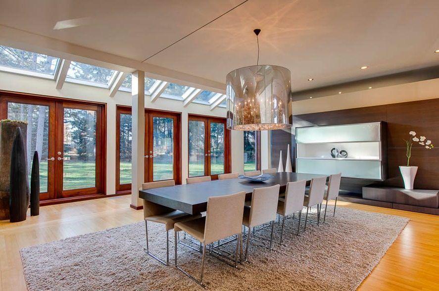 Massive light fixture in a modern Toronto mansion.