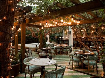 i know its a restaurant patio but i love the lighting beneath the pergola and on the trees - Restaurant Patio