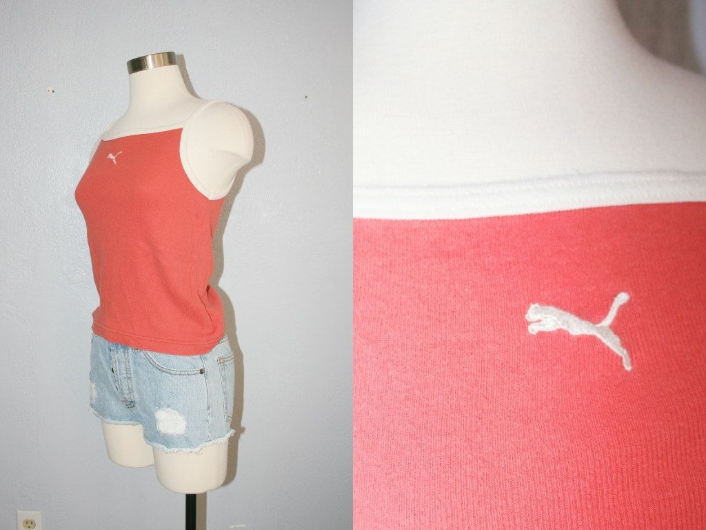 This is a vintage 90s tank top. Light orange tank top with white hem and straps. Embroidered white Puma logo on the front. Brand: Puma Material: 100% cotton Made in the USA Condition: Good vintage condition. Slight wear and piling. No stains or snags.  ☆゚.*・。゚☆゚.*・。゚☆゚.*・。゚☆゚.*・。゚  Size M Length: 16 / 40.5 cm Bust: 32 - 38 / 81 - 96.5 cm Waist: 28 - 32 / 71 - 81 cm  Please feel free to message me with any questions!  ☆゚.*・。゚☆゚.*・。゚☆゚.*・。゚☆゚.*・。゚