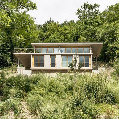 this glazed house built from thick concrete slabs was designed gian salis to follow the slope of a plant covered hill in germanys rhine valley - House Built On Concrete Slab