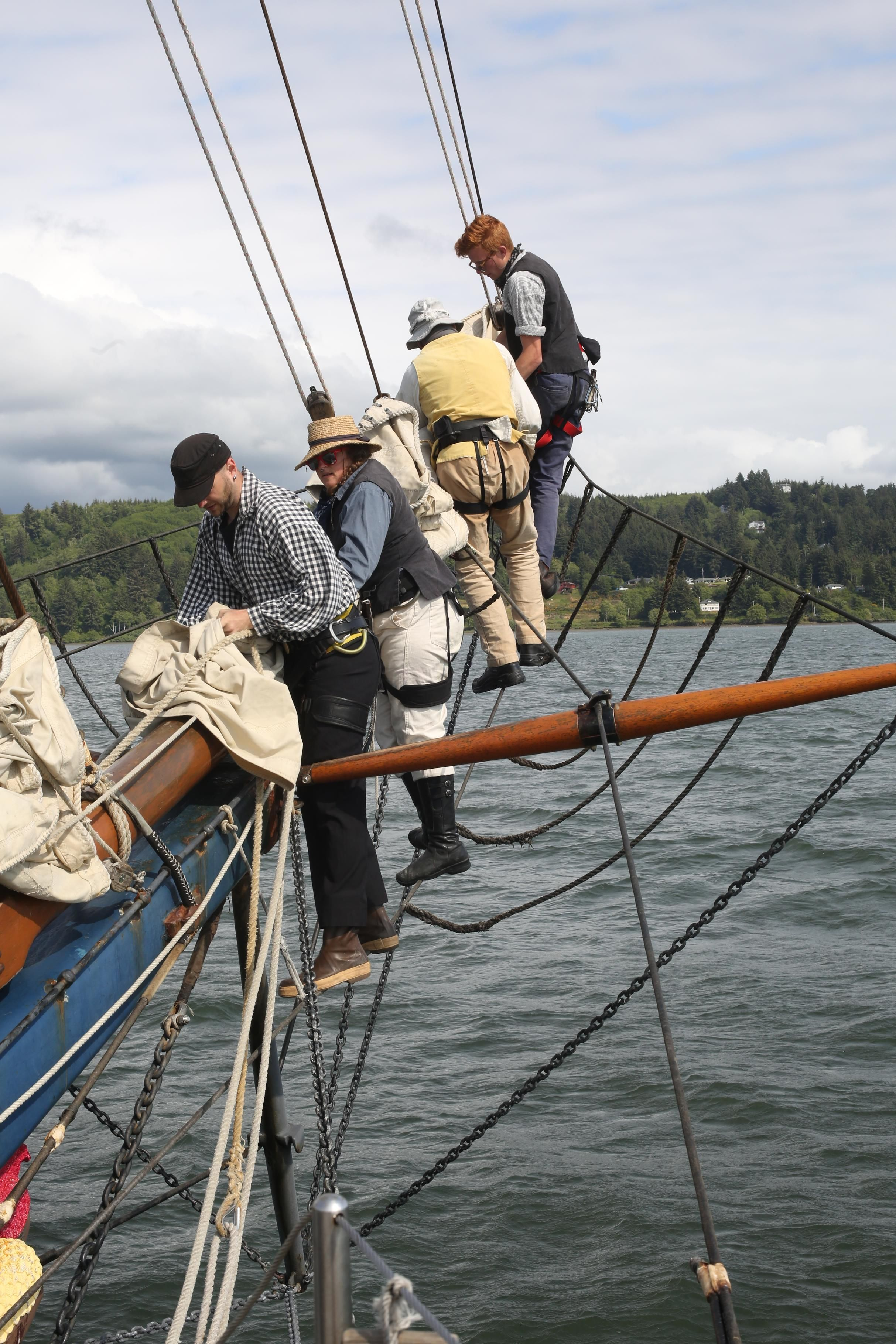 Crew work on the Hawaiian Chieftain's bowsprit in Newport, Ore. #travel #sailing #ships http://historicalseaport.org