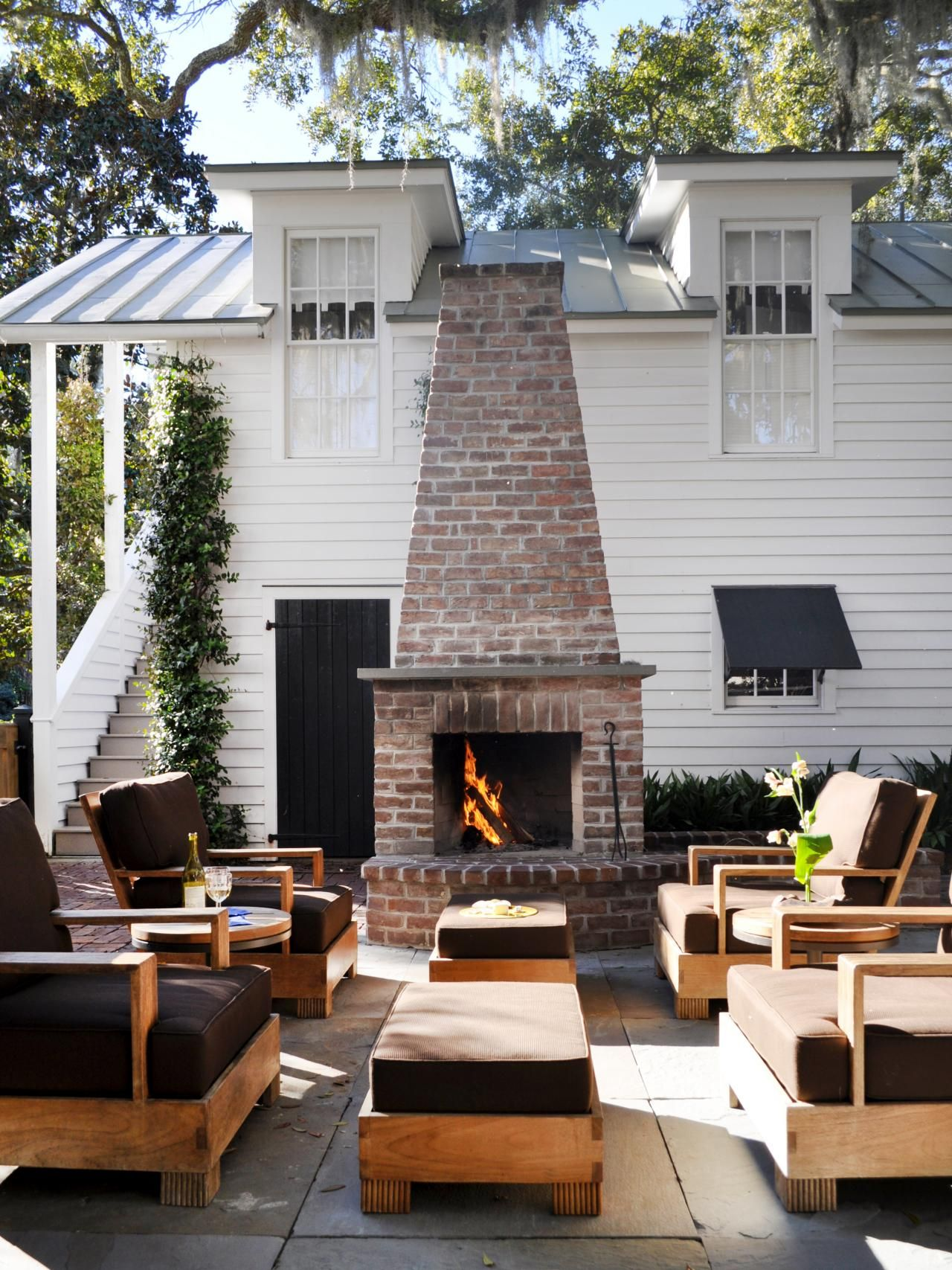 essentials for creating a beautiful outdoor room brick fireplace