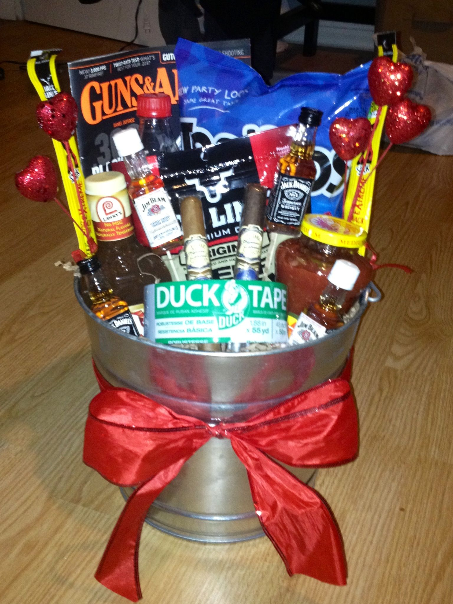 Man basket diy pinterest man basket easter and gift man bouquet i would need twix and bluemoon and maybe some sour straws negle Images