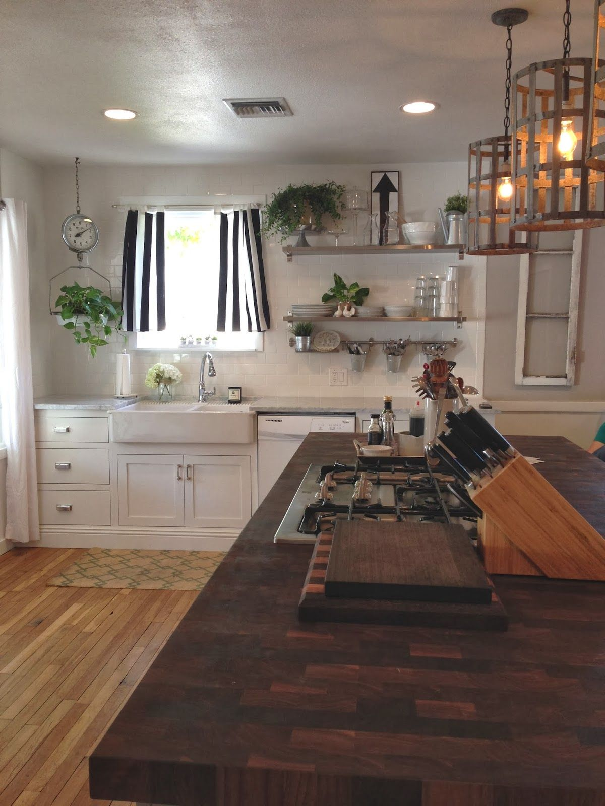 Open shelves near the sink for easy put away! Buckets for