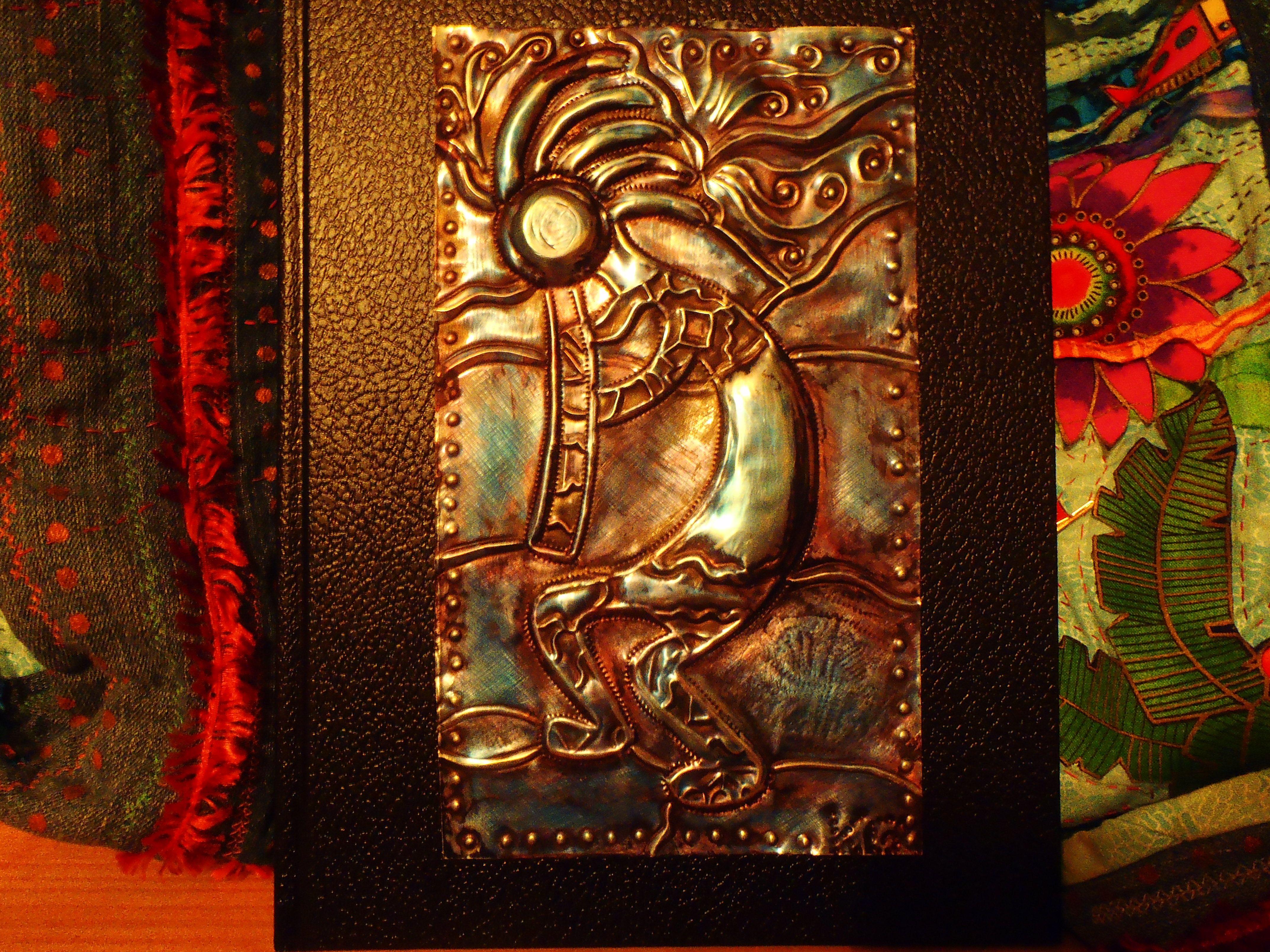 Metal embossing glued onto art journal by Kath G. in Bermuda.