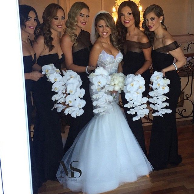 Black Bridesmaid Dresses With White Orchid Bouquets Wedding