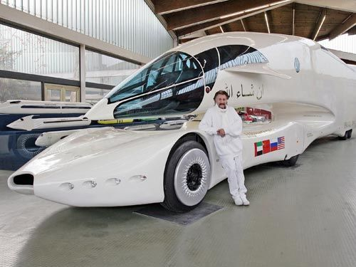 designer luigi colani with one of his truck designs at the
