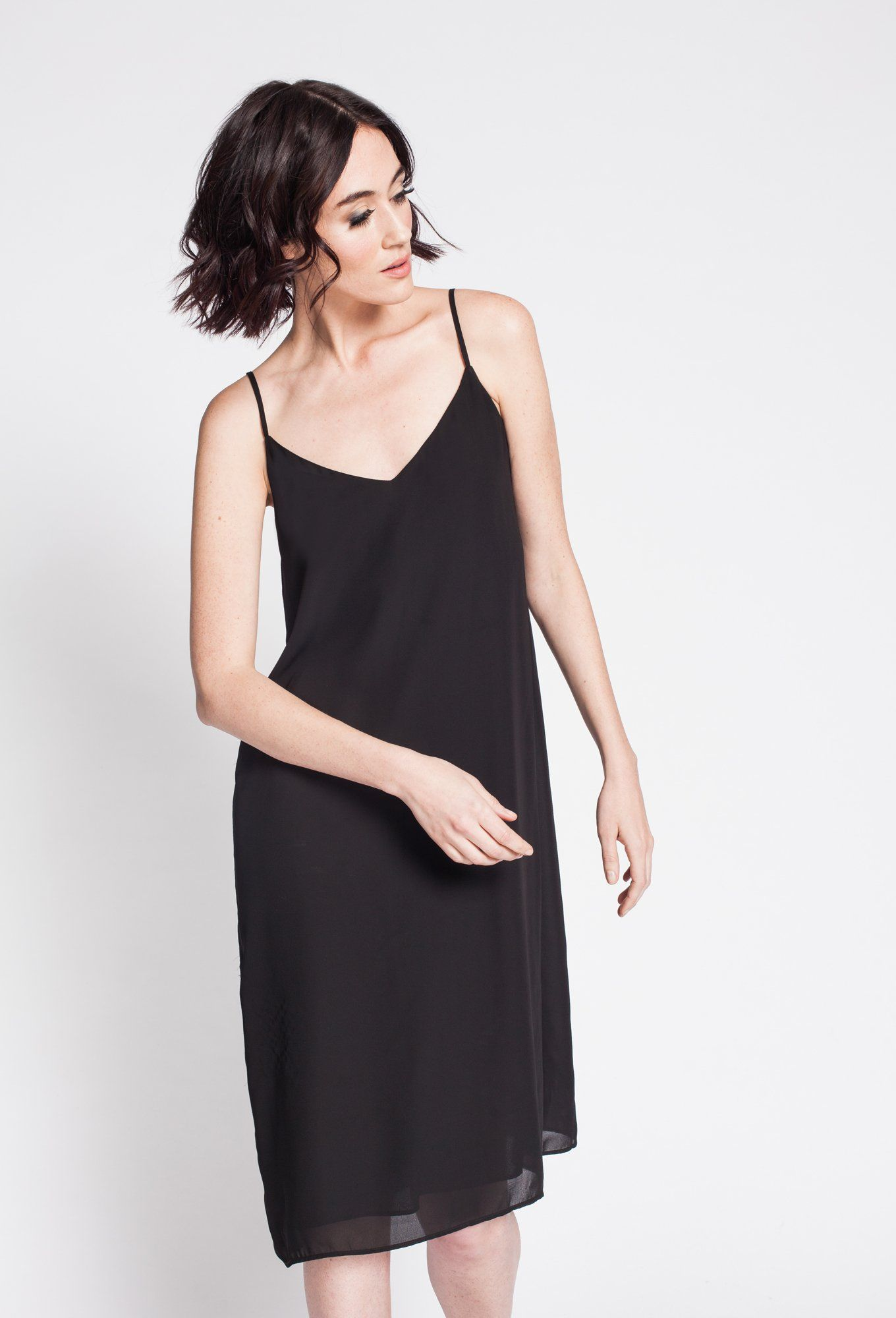 The Piper Slip dress from Noel Asmar. Seen here in Black, also available in Champagne Pink and Luna.