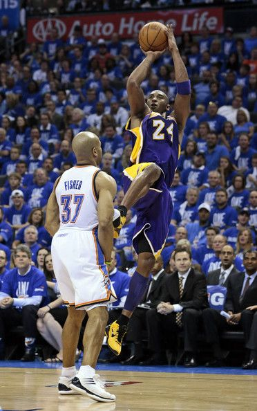 Kobe takers a jumper shot over Fisher.