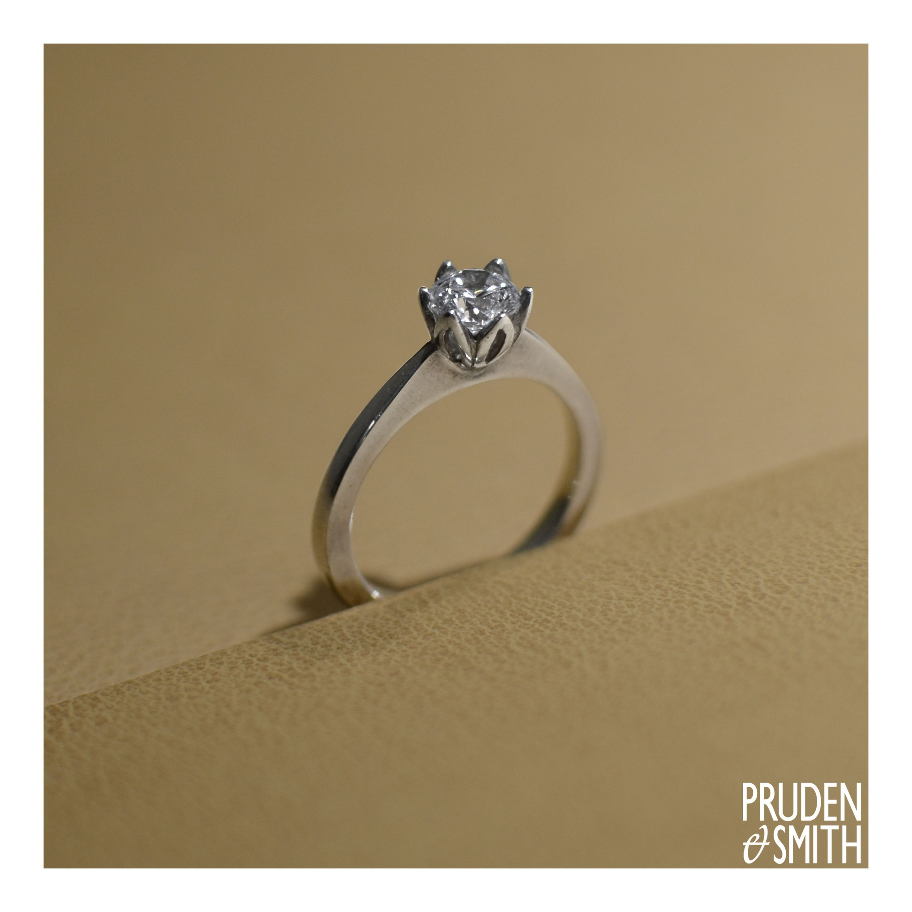 b2e29806902 Our Tulip Ring has a o.6ct round brilliant cut diamond held in place ...