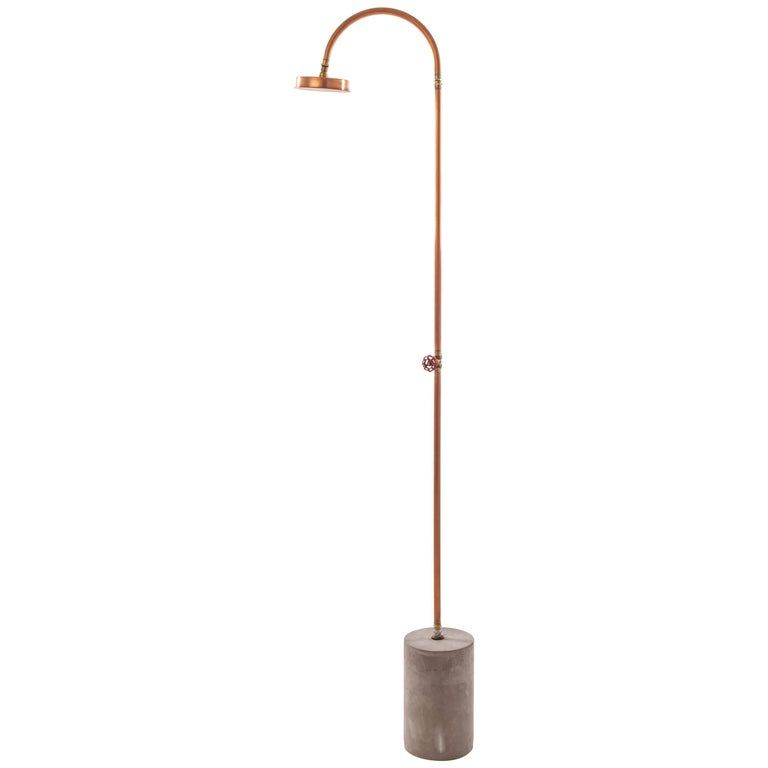 """Photo of Seletti """"Aquart Lux"""" shower and base made of copper and concrete"""