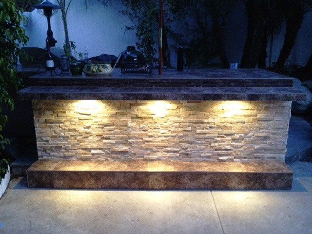 The Catailna Outdoor Kitchen with Stone Veneer Siding Available
