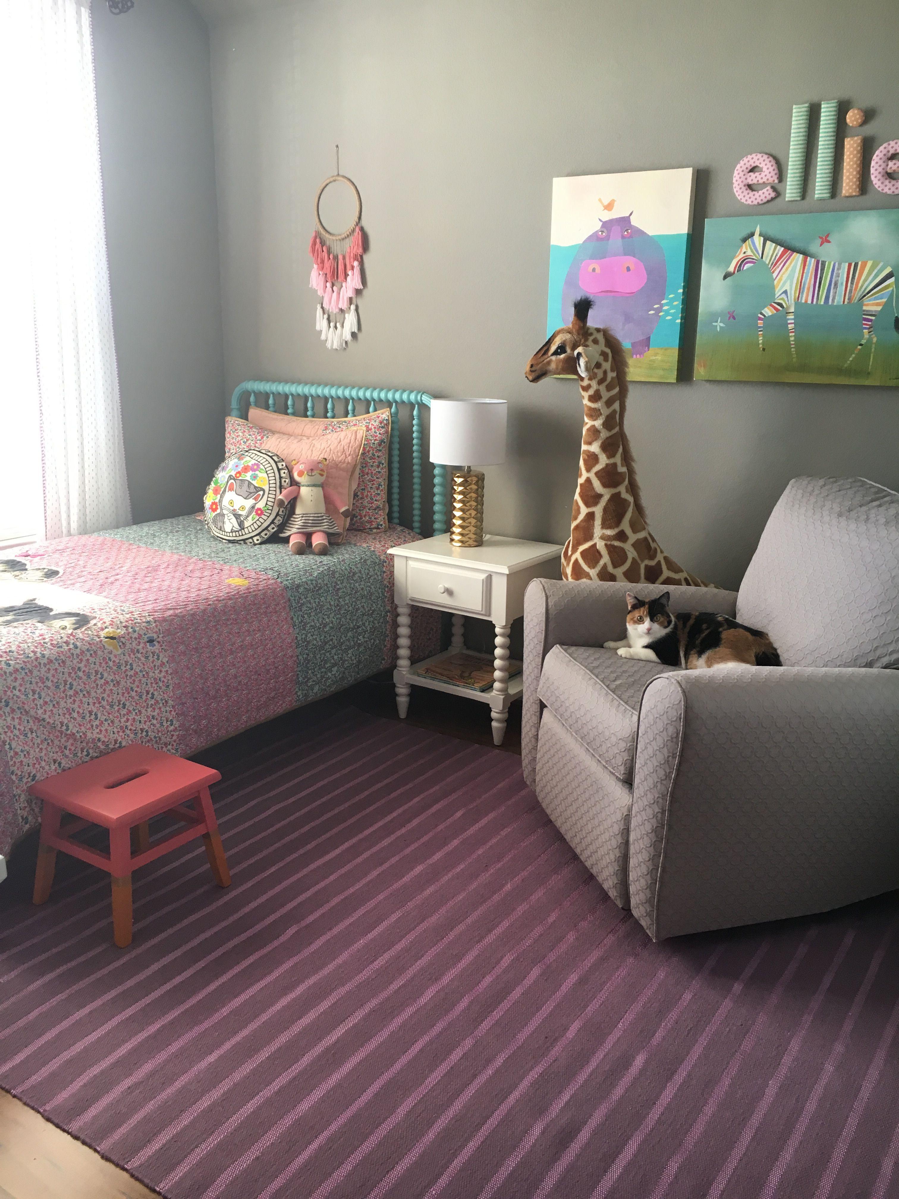 Land of Nod bed, bedding and art. Target rug, bedside