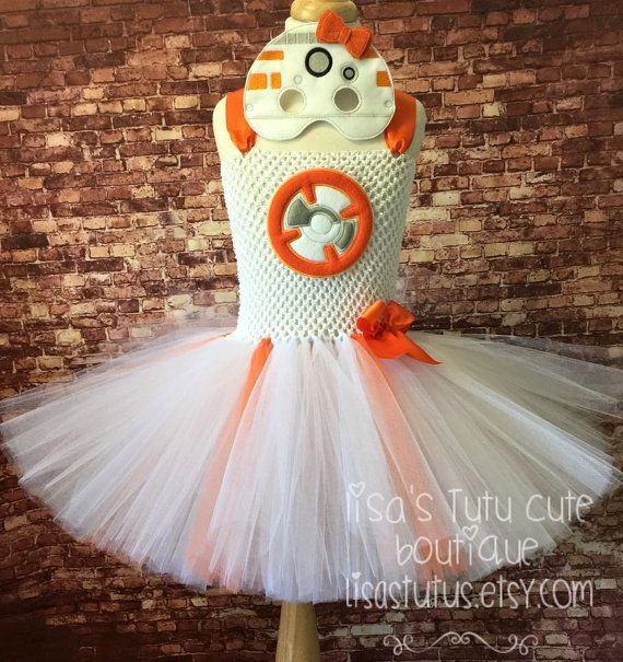 Please read all before purchase.  Give your little girl the treat of a lifetime! Let her celebrate in this awesome BB8 inspired tutu dress! Dress comes on a stretch crochet top with attached tutu. BB8 chest is an embroidered applique. In the event that the embroidered appliqué is not available you will receive one made of glitter vinyl and may differ in appearance. Perfect for that birthday celebration, Halloween, or every day dress up! In the event that an applique is not available the logo…