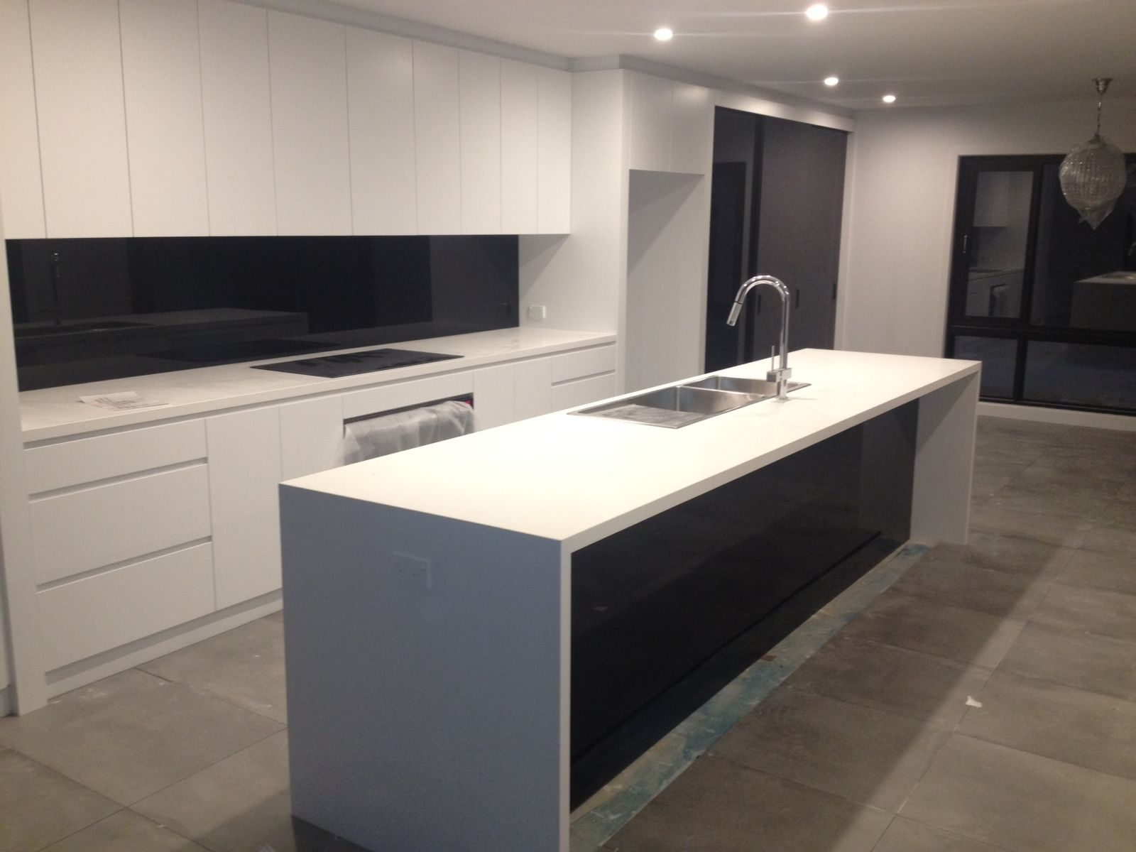 White Satin Polyurethane With 40mm Caesar Stone Pure White Bench Tops With Black Glass Feature