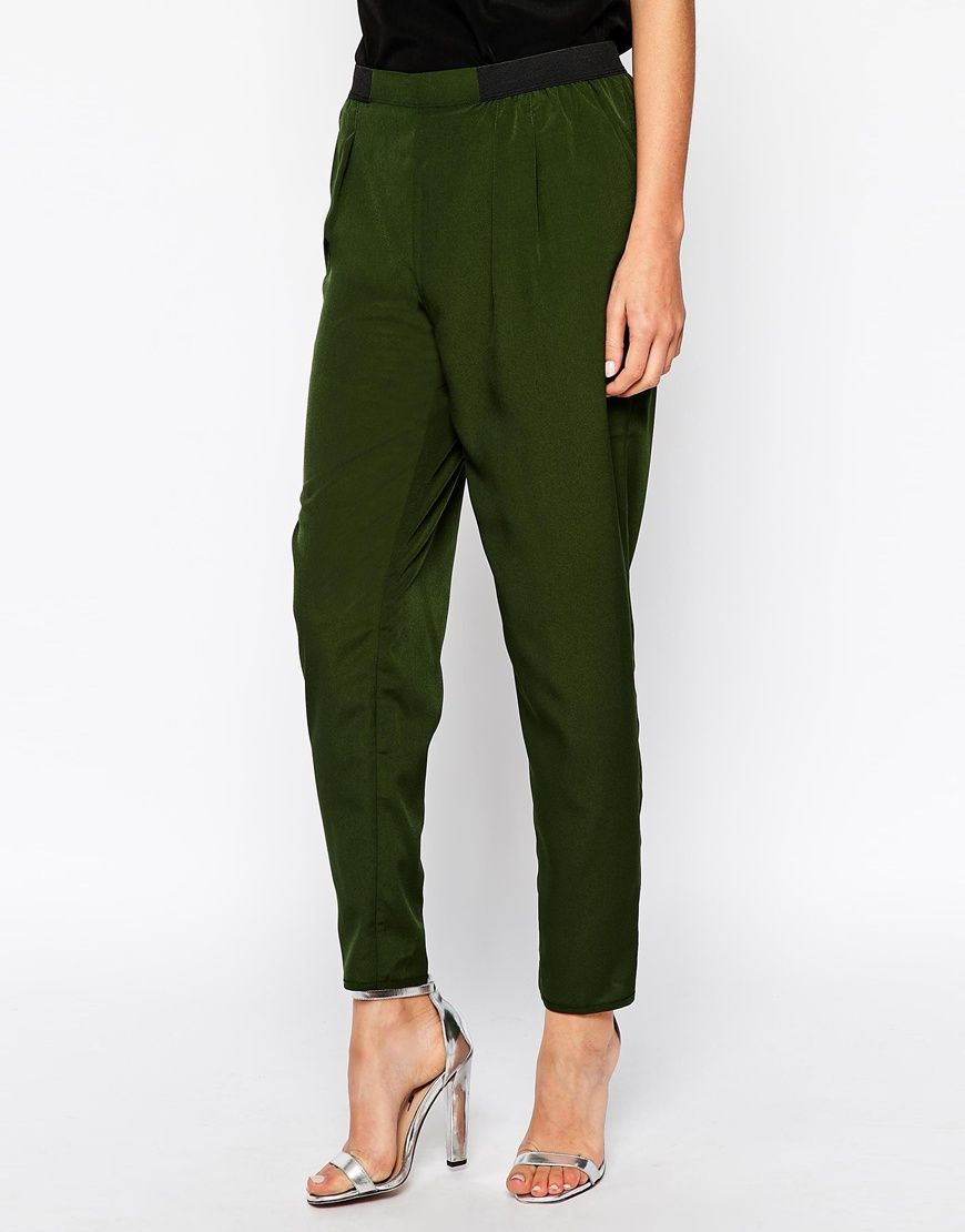 Pants by ASOS Collection Made from a breathable woven fabric. Flattering high rise. Contrast side waistband stretch panels. Side pockets. Tapered leg.