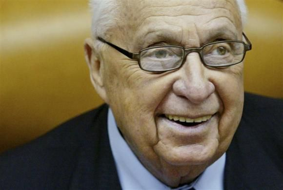 Analysis: A man of war, was Sharon the last leader able to bring peace?   Israeli Prime Minister Ariel Sharon smiles as he speaks during the weekly cabinet meeting at his Jerusalem office in this January 2, 2005 file photo.  Credit: Reuters/Kevin Frayer/Pool/Files