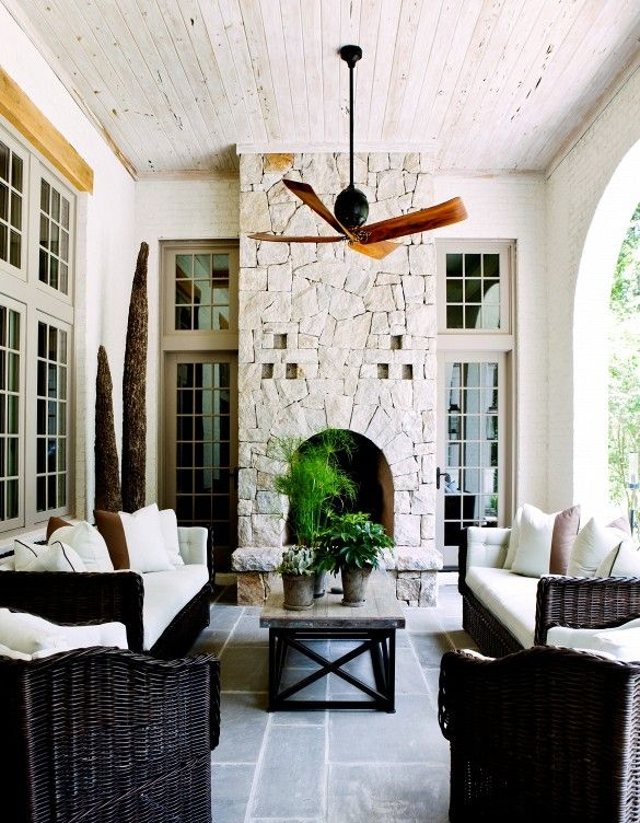 Why It Works: Double Sofas // outdoor furniture, ceiling fan, coffee table, fireplace, stone wall, outdoor space, patio