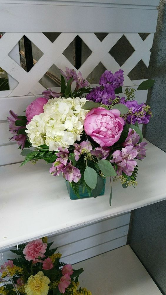 A Summer Mix Of Pink Peonies And White Hydrangea With Purple Stock And Purple Alstromaria In A Teal Cube Fo Flower Delivery Order Flowers Online Flowers Online