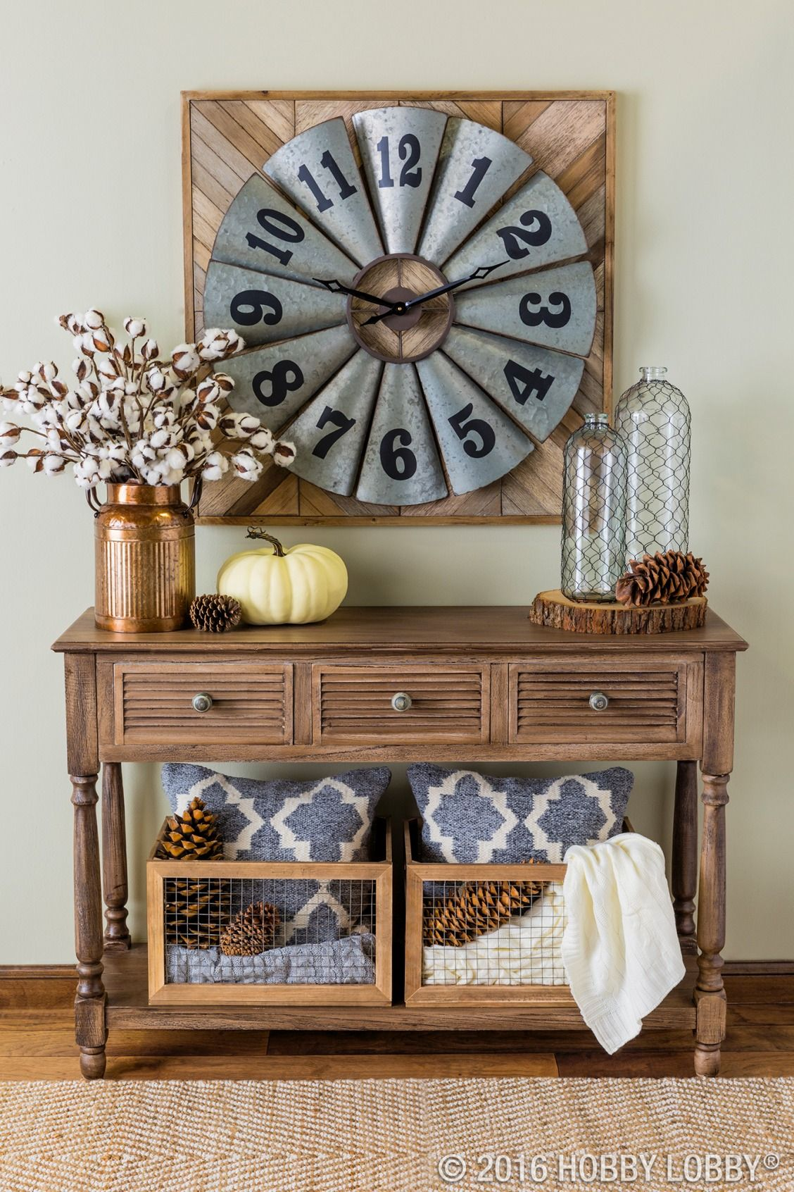 Is it time for an entryway redo? Couple industrial and farmhouse elements for an elegant, earthy feel.