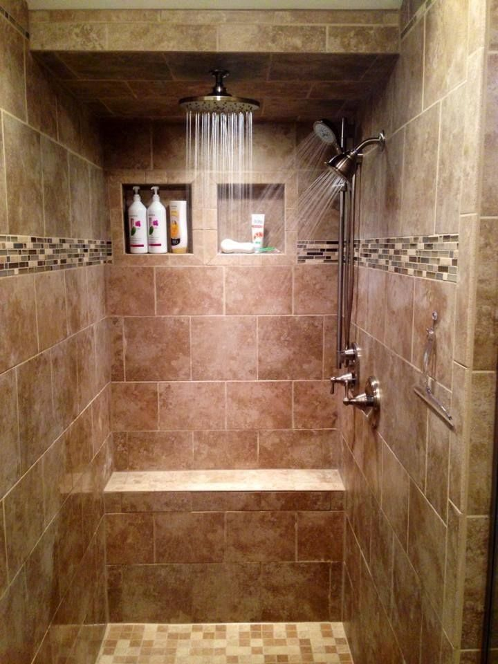 walk-in tile shower, rain shower head, tiled bench, tile shower cubbies,  mosaic glass tile trim.