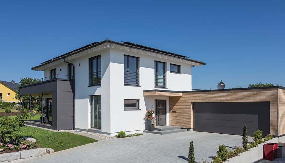 Eingangsbereich mit garage moderne häuser von kitzlingerhaus gmbh & co. kg modern holzwerkstoff transparent | homify