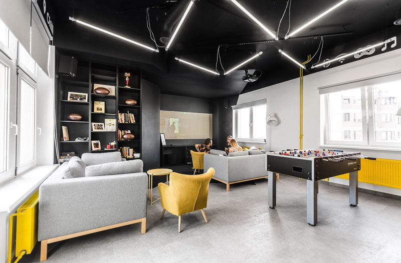 This New Office Interior Uses Wood And Black Frames To Clearly Define Spaces Office Interiors Office Break Room Office Interior Design