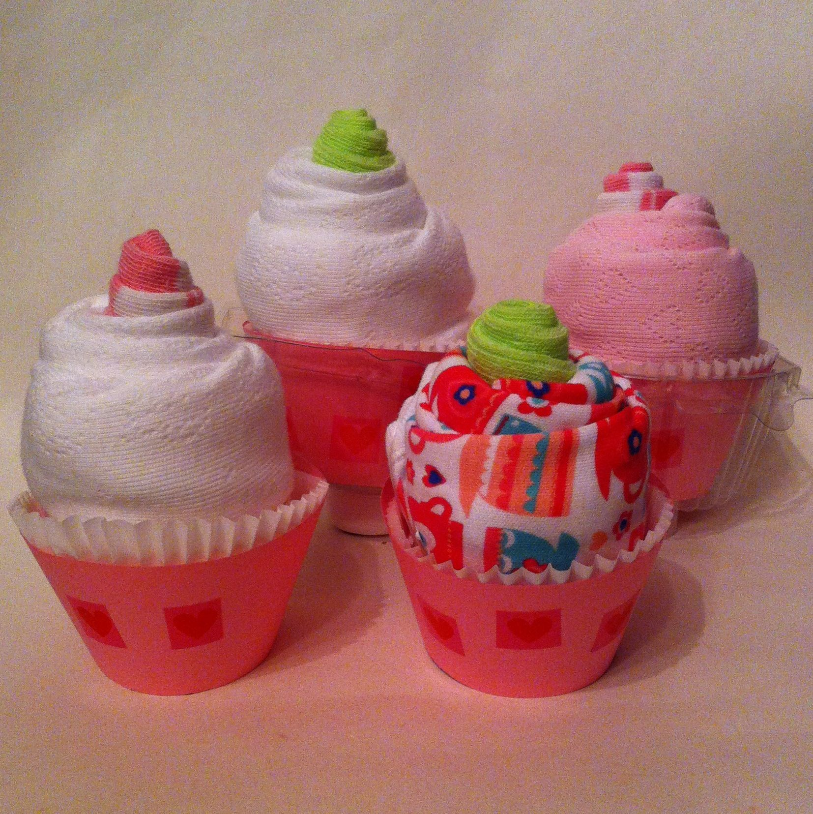 Baby Shower Cupcakes. Made with vests, bibs & socks.