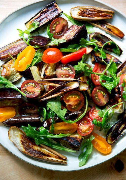 A favorite summer salad: roasted eggplant   cucumber-yogurt sauce (tzatziki)   tomatoes. It's summer on a plate! With some olive oil-toasted bread on the side, call dinner done.