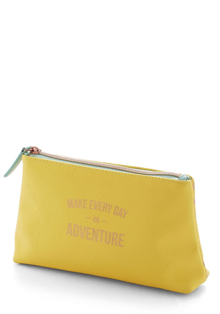 Ready to Ramble Makeup Bag. Keep your primping essentials in this yellow makeup bag from Wild  Wolf, and youll always be prepared when wanderlust strikes! #yellow #modcloth