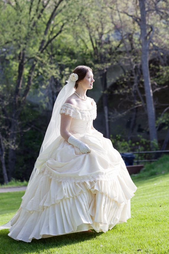 This ready made one of a kind ornate 1860s bridal ensemble beautifully depicts