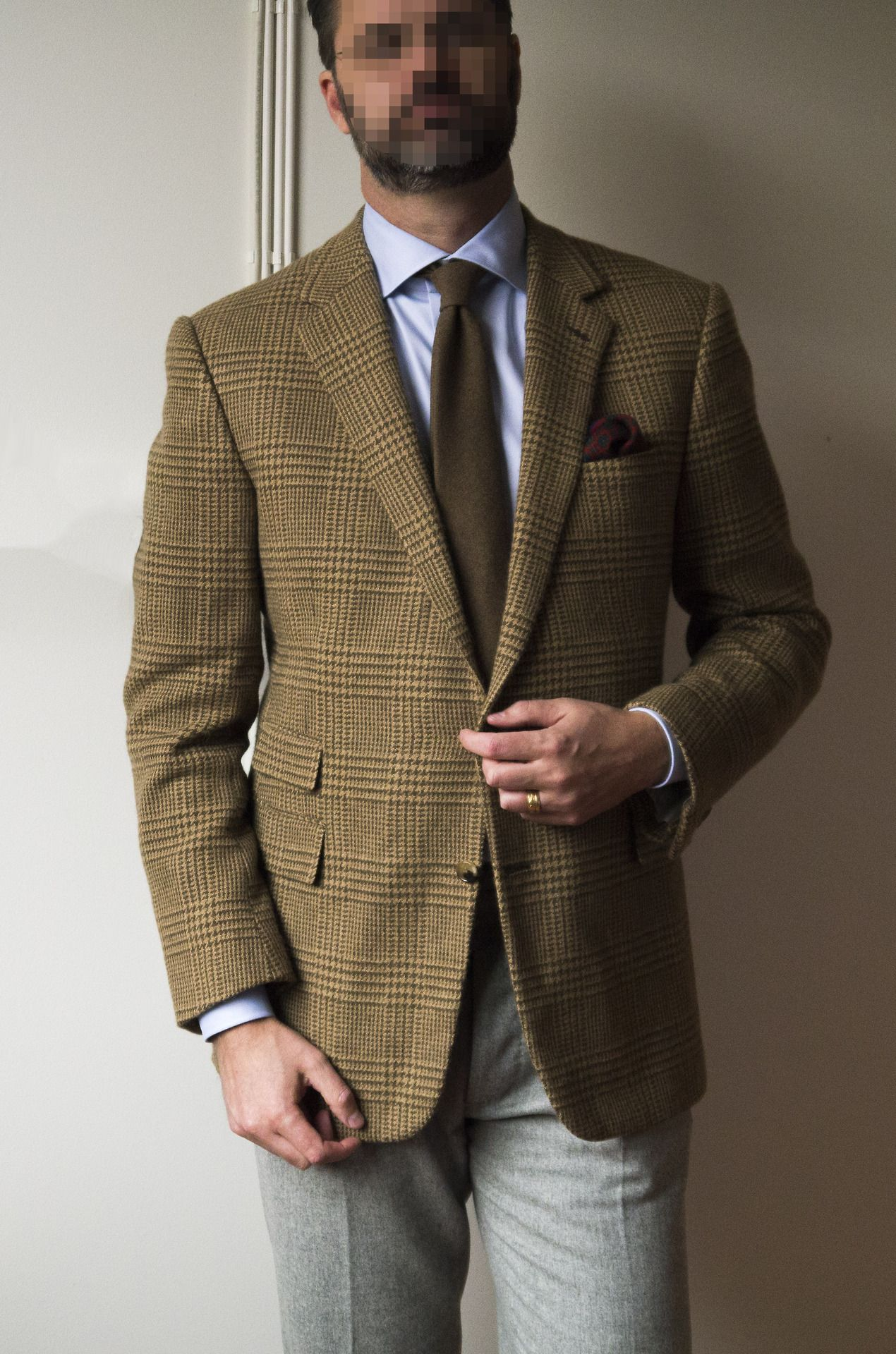 Tan tweed sport coat, light blue shirt, brown tie, light grey ...