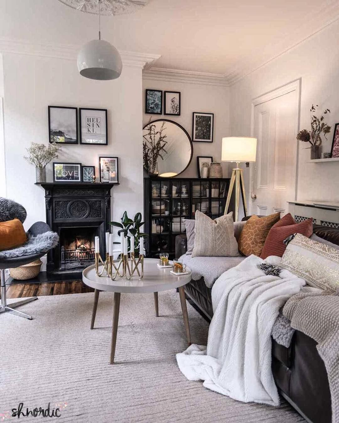 Monochrome can still be cosy and inviting white walls and black furniture combined with soft natural textures and gold details