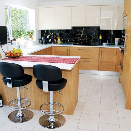 Small Kitchen With Oak Cabinetry, Black Marble Splashback, White Worktop, Breakfast  Bar And