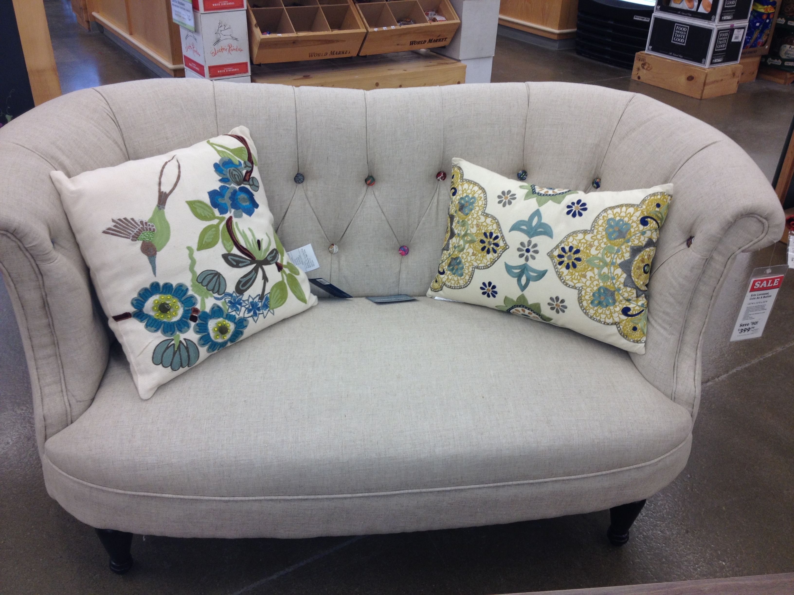 World market couch. Each of the buttons have a different design, so it practically matches with anything.