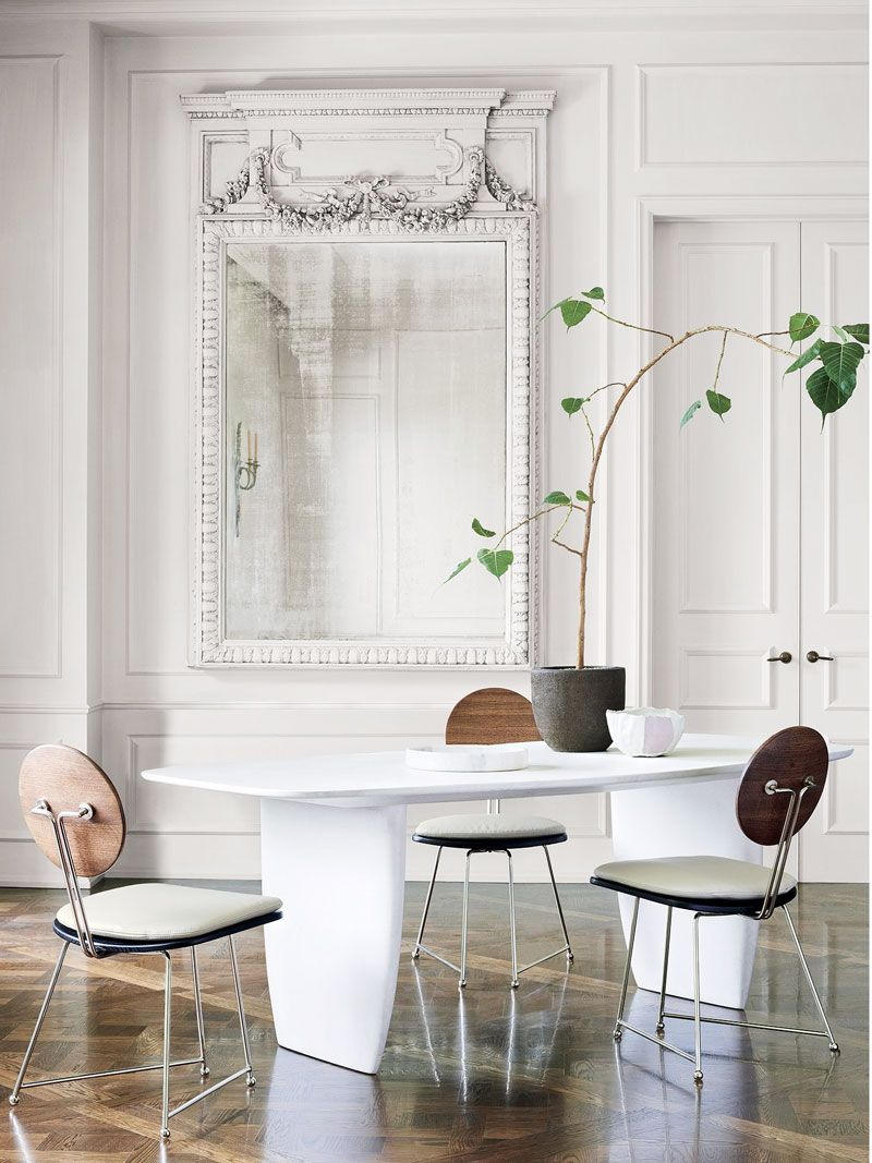Round back dining chair and white concrete dining table in cb2 x goop collection on thou swell thouswellblog