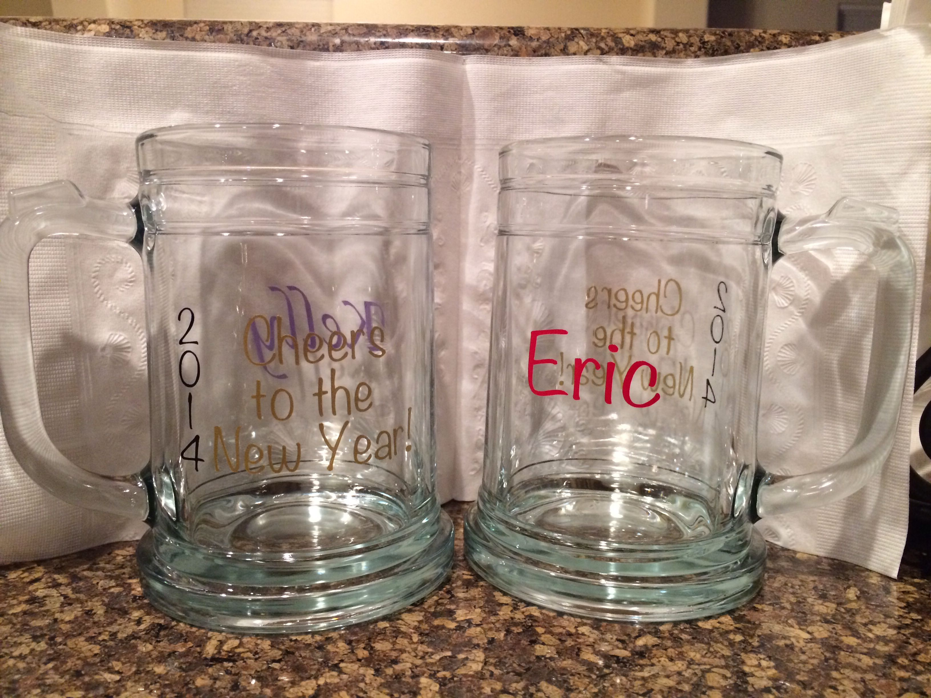 """""""2014 Cheers to the New Year"""" glasses I made  for our guests on New Years Eve."""