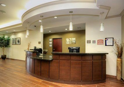 Very Nice Front Desk And Ceiling Lighting Above Soffit