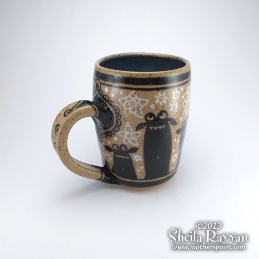 Monsters in the Snowflakes  decorative ceramic mug by MotherSpoon, $50.00