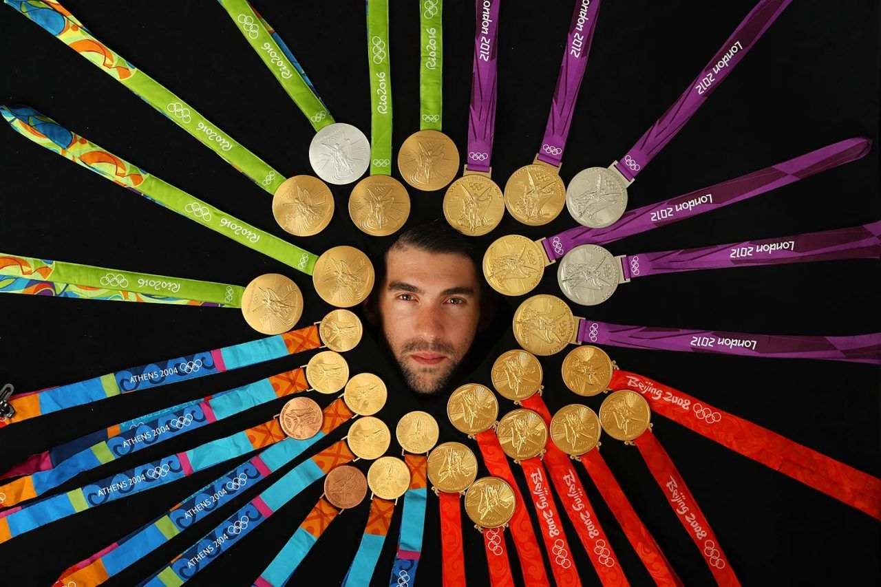 b2dcdcb9ed Michael Phelps poses with all 28 of his Olympic medals, 23 of them gold,  during an SI photo shoot following the 2016 Rio Olympics.
